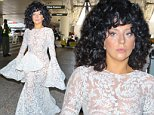 Please contact X17 before any use of these exclusive photos - x17@x17agency.com   Lady Gaga brings the glamour to LAX wearing a white see through lace dress greeting fans October 10, 2014 X17online.com EXCL
