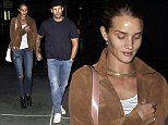 UK CLIENTS MUST CREDIT: AKM-GSI ONLY EXCLUSIVE: Hollywood, CA - Jason Statham and his girlfriend Rosie Huntington-Whiteley hold hands after a movie date night at ArcLight Cinemas in Hollywood.  The camera shy supermodel smiled bashfully, while her action star boyfriend shot the camera a mean look.  Pictured: Jason Statham, Rosie Huntington-Whiteley Ref: SPL864427  121014   EXCLUSIVE Picture by: AKM-GSI / Splash News