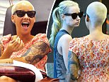 EXCLUSIVE: Amber Rose was all smiles while getting a manicure in Hollywood. The model and ex-wife of Wiz Khalifa was seen texting while getting her nails done, on her way out, Amber bumped into Hip Hop star Iggy Azalea who had just arrived for her mani-pedi appointment.\n\nPictured: Amber Rose\nRef: SPL864521  141014   EXCLUSIVE\nPicture by: Sharpshooter Images /Splash\n\nSplash News and Pictures\nLos Angeles: 310-821-2666\nNew York: 212-619-2666\nLondon: 870-934-2666\nphotodesk@splashnews.com\n