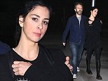 UK CLIENTS MUST CREDIT: AKM-GSI ONLY EXCLUSIVE: Hollywood, CA - Michael Sheen and Sarah Silverman keep close as they leave ArcLight Cinemas in Hollywood.  The cute couple reported caught a showing of David Fincher  s   Gone Girl  .  The raunchy comedienne kept it simple in an all black ensemble with a pair of Dr. Marten boots for her night out at the movies.  Pictured: Michael Sheen, Sarah Silverman Ref: SPL865029  131014   EXCLUSIVE Picture by: AKM-GSI / Splash News