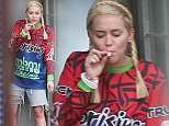 EXCLUSIVE TO INF. PLEASE CALL FOR PRICING. STRICTLY NO ONLINE USAGE. October 13, 2014: Miley Cyrus smoking a suspicious-looking rolled-up cigarette in Sydney, Australia. Mandatory Credit: INFphoto.com Ref: infausy-12/21
