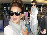 Actress Kate Beckinsale as ever looks effortlessly chic in pink heels and a grey trouser suit as she arrives at Los Angeles International Airport for a flight. \n\nPictured: Kate Beckinsale\nRef: SPL864232  131014  \nPicture by: MOVI Inc. / Splash News\n\nSplash News and Pictures\nLos Angeles: 310-821-2666\nNew York: 212-619-2666\nLondon: 870-934-2666\nphotodesk@splashnews.com\n