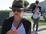 Los Angeles, CA - Actress, Sarah Michelle Gellar, looking street chic in a cropped black blazer, sheer white t shirt, grey distressed jeans, black & white canvas shoes, brown fedora hat, and a Gucci handbag.    AKM-GSI       October 13, 2014 To License These Photos, Please Contact : Steve Ginsburg (310) 505-8447 (323) 423-9397 steve@akmgsi.com sales@akmgsi.com or Maria Buda (917) 242-1505 mbuda@akmgsi.com ginsburgspalyinc@gmail.com