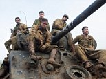 "This photo released by Sony Pictures Entertainment shows, from left, Shia LaBeouf as Boyd ""Bible"" Swan, Logan Lerman as Norman, Brad Pitt as Sgt. Don ìWardaddyî Collier, Michael Pena as Trini ""Gordo"" Garcia, and Jon Bernthal as Grady ""Coon-Ass"" Travis, in Columbia Pictures' ""Fury."" Before the World War II tank drama reaches theaters Oct. 17, gamers can make like Pitt's character and steer a virtual rendition of the M4A3E8 Sherman tank he commands in the film in the game ""World of Tanks."" It's the latest example of a likeminded movie and game aligning to hype each other, and it marks the first Hollywood pact for the popular online tank combat title. (AP Photo/Sony Pictures Entertainment, Giles Keyte)"