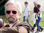 "UK CLIENTS MUST CREDIT: AKM-GSI ONLY\nEXCLUSIVE: Atlanta, GA - Michael Douglas takes a break on the set of ""Ant-Man"", currently filming in Atlanta.  The father-of-three had his youngest son Dylan and his daughter on Carys on set.  Michael grew out his beard and was suited up in brown, filming a scene in an older convertible.  The Marvel based movie is scheduled to be released next year, also starring Paul Rudd as ""Ant Man"".\n\nPictured: Michael Douglas\nRef: SPL864850  131014   EXCLUSIVE\nPicture by: AKM-GSI / Splash News\n\n"
