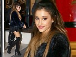Ariana Grande greets fans in Paris wearing over the knee boots and a black fur jacket. October 14, 2014 X17online.com