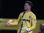 Gillingham goalkeeper Stuart Nelson celebrates during the penalty shoot-out - Colchester United vs Gillingham - Johnstones Paint Trophy Football at the Weston Homes Community Stadium, Colchester, Essex - 07/10/14 - MANDATORY CREDIT: Gavin Ellis/TGSPHOTO - Self billing applies where appropriate - contact@tgsphoto.co.uk - NO UNPAID USE