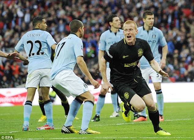 Unbelievable scenes: Watson wheels away after nodding home the winner, leaving City players disconsolate