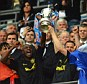 Silverware: Emmerson Boyce and Gary Caldwell lift the FA Cup after Wigan's dramatic success