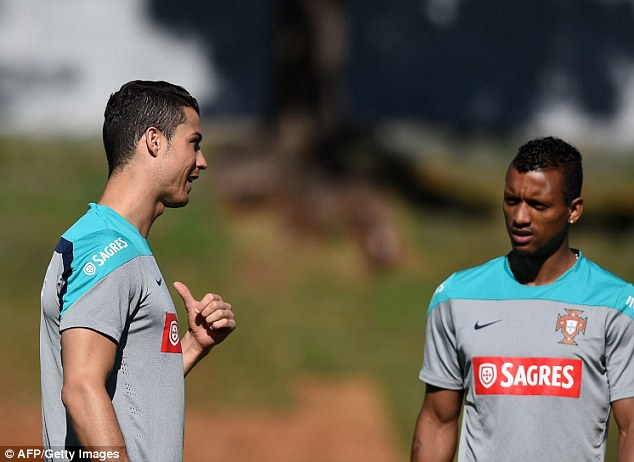I'm in charge: Nani doesn't look too impressed by what Ronaldo is saying