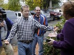 Sen. Rand Paul, R-Ky., is greeted by state GOP Chair Jennifer Horn at the party headquarters Thursday Oct. 16, 2014 in Concord, N.H. The possible 2016 Republican presidential candidate was in the nation's first presidential primary state to rally voters ahead of the November election. (AP Photo/Jim Cole)