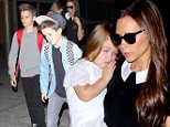 Victoria Beckham and her little ones, Romeo, Cruz and Harper, returned to the City of Angles by way of LAX.  The former Spice Girl was dressed in black and white, with sunglasses, on Thursday, October 16, 2014  X17online.com