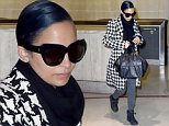 UK CLIENTS MUST CREDIT: AKM-GSI ONLY\nEXCLUSIVE: Los Angeles, CA - Nicole Richie is looking stylish for her LAX departure.  Nicole clutches her black leather purse wearing a black and white coat with a black scarf, gray pants and black shoes.\n\nPictured: Nicole Richie\nRef: SPL866999  151014   EXCLUSIVE\nPicture by: AKM-GSI / Splash News\n\n
