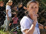 Charlize Theron having a cigarette break with her son Jackson in Cape Town, South Africa where she is filming The Last Face.\\nNoble Draper Pictures.\\n**BYLINE: NOBLE/DRAPER**
