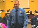 FILE - In this  Feb. 11, 2014 file image from video released by the City of Ferguson, Mo., officer Darren Wilson attends a city council meeting in Ferguson. Wilson has told authorities that Michael Brown reached for the gun during a scuffle, the Times reported in a story posted on its website Friday night Oct. 17, 2014.   (AP Photo/City of Ferguson, File)