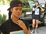 UK CLIENTS MUST CREDIT: AKM-GSI ONLY EXCLUSIVE: West Hollywood, CA - Singer, Rihanna, seen arriving at a hotel in Los Angeles.  She was wearing a backwards black cap, oversized graphic sleeveless hoodie, denim jeans, colorful socks, and Converse sneakers.  Pictured: Rihanna Ref: SPL867469  161014   EXCLUSIVE Picture by: AKM-GSI / Splash News