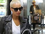 Picture Shows: Amber Rose  October 16, 2014    Model Amber Rose out picking up some groceries with a mystery man at Ralph's in Los Angeles, California.     Actor Nick Cannon recently responded to rumours about him and Amber stating that she is just someone he is managing saying she is 'truly an icon when it comes to fashion, style, and even just someone in pop culture.'     Exclusive - All Round  UK RIGHTS ONLY     Pictures by : FameFlynet UK    2014  Tel : +44 (0)20 3551 5049  Email : info@fameflynet.uk.com