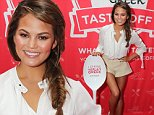 NEW YORK, NY - OCTOBER 17:  Model Chrissy Teigen poses at the Yoplait station at the Blue Moon Burger Bash presented by Pat LaFrieda Meats hosted by Rachael Ray during the New York City Wine & Food Festival at Esurance Rooftop Pier 92 on October 17, 2014 in New York City.  (Photo by Neilson Barnard/Getty Images for NYCWFF)