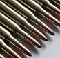 Bullets Lined Up, Extreme Close-Up --- Image by © Yves Regaldi/PhotoAlto/Corbis
