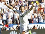 Real Madrid's Cristiano Ronaldo celebrates after scoring against Levante during a Spanish La Liga soccer match at the Ciutat de Valencia stadium in Valencia, Spain, on Saturday, Oct. 18, 2014.(AP Photo/Alberto Saiz)