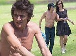 EXCLUSIVE: A relaxed shirtless Ronnie Wood spent the sunny afternoon relaxing in the sun and getting romantic with wife Sally Humphreys. Ronnie looked to be enjoying the warm weather as he removed his t shirt and hat and baked in the sun. Ronnie and wife Sally looked really happy together sharing kisses and affection for one another. Ronnie Wood and Wife Sally Humphreys then proceeded to take a walk around the gardens looking like any other couple. Ronnie and the band have been busily rehearsing for their upcoming Australian tour for the past couple of days. The Rolling Stones play a sold out show in a weeks time at Adelaide Oval.\n\nPictured: Ronnie Wood and Sally Humphreys\n\nRef: SPL868750  181014   EXCLUSIVE\nPicture by: Splash\n\nSplash News and Pictures\nLos Angeles: 310-821-2666\nNew York: 212-619-2666\nLondon: 870-934-2666\nphotodesk@splashnews.com\n