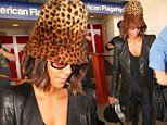 Los Angeles, CA - Halle Berry makes her return to Los Angeles on an incoming flight at LAX. The actress left with long locks and returned with shoulder length hair as she kept her head down and under a cheetah print Kangol hat\nwhile being escorted to her ride through a swarm of photographers.\nAKM-GSI         October 17, 2014 \nTo License These Photos, Please Contact :\nSteve Ginsburg\n(310) 505-8447\n(323) 423-9397\nsteve@akmgsi.com\nsales@akmgsi.com\nor\nMaria Buda\n(917) 242-1505\nmbuda@akmgsi.com\nginsburgspalyinc@gmail.com\n