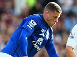 LIVERPOOL, ENGLAND - OCTOBER 18:  Ross Barkley of Everton is challenged by Tom Cleverley of Aston Villa during the Barclays Premier League match between Everton and Aston Villa at Goodison Park on October 18, 2014 in Liverpool, England.  (Photo by Jan Kruger/Getty Images)