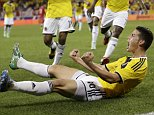 Colombia's James Rodriguez celebrates after scoring a goal against Canada during the second half of an international soccer friendly match, Tuesday, Oct. 14, 2014, in Harrison, N.J. (AP Photo/Julio Cortez)