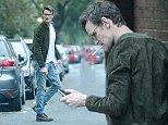 EXCLUSIVE Matt Smith pictured out in London. While walking Matt drops his phone on the floor then inspects the damage. Later the former Doctor Who star is seen with his hand down the front of his jeans adjusting his underwear.\n18 October 2014.\nPlease byline: KP/Vantagenews.co.uk