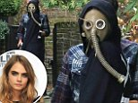 EXCLUSIVE Cara Delevingne seen leaving a studio in north london wearing  a Gas Mask. The model was seen later going to The wellington Women's Clinic before arriving back home with the Gas Mask in her hand. \n15 October 2014.\nPlease byline: Vantagenews.co.uk