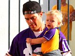 Please contact X17 before any use of these exclusive photos - x17@x17agency.com   Early birds football fan Josh Duhamel carrying supercute son Axl are Minnesota Vikings fans with jersey number 10 quarterback Tarkenton oct 19, 2014 X17online.com