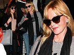 Melanie Griffith was spotted at LAX, with daughter and star of 50 Shades of Gray, Dakota Johnson.  The pair were returning to LA, Melanie in jeans, a sweatshirt and a scarf, while Dakota was dressed in a black jacket and pants with a peach top.  Dakota recently admitted to news outlets that she doesn't want her mom to see the film.   Sunday, October 19, 2014  X17online.com