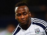 WEST BROMWICH, ENGLAND - OCTOBER 20:  Saido Berahino of West Bromwich Albion scores their second goal as Rafael of Manchester United looks on during the Barclays Premier League match between West Bromwich Albion and Manchester United at The Hawthorns on October 20, 2014 in West Bromwich, England.  (Photo by Laurence Griffiths/Getty Images)