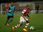 Arsenal's Theo Walcott makes comeback after injury in u21's