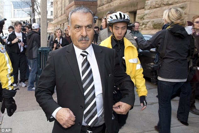 Support: Mohammed Jaser, father of Raed Jaser, leaves court in Toronto on Tuesday, April 23, 2013. His son is accused with another man of plotting to derail a train in Canada with support from al-Qaida elements in Iran