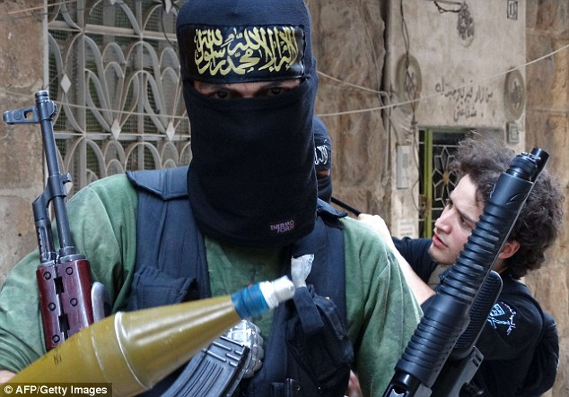 An Islamist fighter holds weapons in the war-battered Syrian city of Aleppo. The Charity Commission said cash 'undoubtedly' ends up in the hands of extremist groups