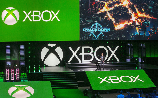 Phil Spencer, head of Microsoft's Xbox division and Microsoft Studios, presents a fresh installment of the open-world romp 'Crackdown,' for the Xbox One, during a presentation ahead of the Electronic Entertainment Expo at the University of Southern California's Galen Center on Monday