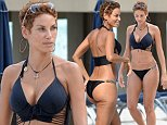 EXCLUSIVE TO INF.\nOctober 20, 2014: Nicole Murphy, mother of four, ex wife of Eddie Murphy, and ex partner of Michael Strahan - Strahan is an ex Giants football player and host of morning show 'Kelly And Michael' - shows off her curves in a black lace up bikini while enjoying some time on Miami Beach, Florida with friends.\nMandatory Credit: INFphoto.com Ref: infusmi-13|sp|CODE000