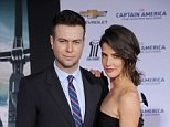 """HOLLYWOOD, CA - MARCH 13: Actress Cobie Smulders and husband Taran Killam arrive at the Los Angeles premiere of """"Captain America: The Winter Soldier"""" at the El Capitan Theatre on March 13, 2014 in Hollywood, California.  (Photo by Gregg DeGuire/WireImage)"""