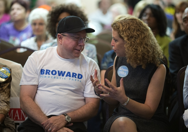 DNC Chairwoman Debbie Wasserman Schultz, right, talks to Ken Evans as they watched the final debate between the two candidates running for governor, in Plant...