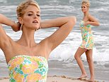 EXCLUSIVE TO INF.\nOctober 22, 2014: Model Erin Heatherton is seen posing in a floral dress on the beach for a photoshoot in Miami Beach, Florida.\nMandatory Credit: INFphoto.com Ref: infusmi-13|sp|CODE000
