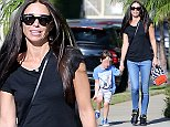 EXCLUSIVE. COLEMAN-RAYNER. Los Angeles, CA, USA. \\nOctober 21st, 2014\\nErica Packer decides to spend some quality time with her children since her alleged boyfriend Orlando Bloom has jetted out of Los Angeles with Selena Gomez. The Ex-Mrs. Packer is seen here walking through her neighborhood with her son Jackson who fancies himself an American now.  Jackson proudly wears a USA shirt as he skips down the side walk.\\nCREDIT LINE MUST READ: Coleman-Rayner\\nTel US (001) 323 545 7584 - Mobile\\nTel US (001) 310 474 4343 - Office\\nwww.coleman-rayner.com