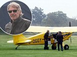 Harrison Ford seen out at an airfiled working on a plane before taking it flying....\n\nPic: Greg Brennan 07930877317