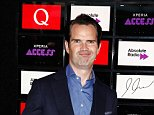 LONDON, ENGLAND - OCTOBER 22:  Jimmy Carr poses for photos in front of the worlds first digital branding board from Sony at the Xperia Access Q Awards at The Grosvenor House Hotel on October 22, 2014 in London, England.  (Photo by Tim P. Whitby/Getty Images for Sony)