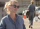 EXCLUSIVE TO INF.\nOctober 22, 2014: Julia Roberts looks more like a mechanic or a train conductor than a mom as she wears a blue denim jumper while bringing white lanterns for a school play for Phinnaeus and Hazel Moder, Malibu, CA,\nMandatory Credit: Borisio/INFphoto.com Ref.: infusla-277|sp|CODE000