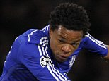 Chelseas French striker Loic Remy shoots to score the opening goal of the UEFA Champions League, Group G, football match between Chelsea and Maribor at Stamford Bridge in London on October 21, 2014. AFP PHOTO / IAN KINGTONIAN KINGTON/AFP/Getty Images