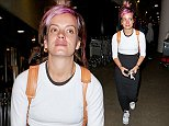 Lily Allen looks cute with purple hair while sporting a long black skirt at LAX. October 22, 2014 X17online.com