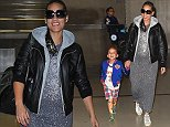 Los Angeles, CA - Alicia Keys smiles wide as she makes her way through LAX Airport with her son Egypt following a late flight into Los Angeles.  Alicia, who is pregnant with her second child, is currently a mentor to Pharrell Williams   team on   The Voice  .  The braided R&B singer wore a black leather jacket over a splatter painted grey dress, white sneakers and a pair of sunglasses.   AKM-GSI        October 22, 2014 To License These Photos, Please Contact : Steve Ginsburg (310) 505-8447 (323) 423-9397 steve@akmgsi.com sales@akmgsi.com or Maria Buda (917) 242-1505 mbuda@akmgsi.com ginsburgspalyinc@gmail.com