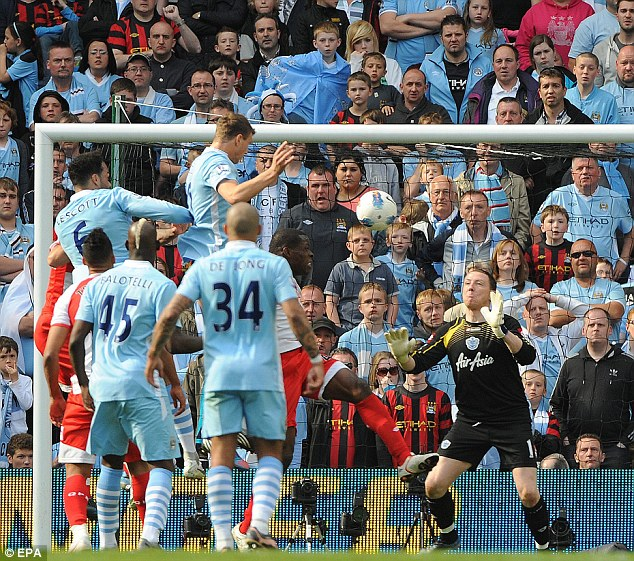 Keeping the miracle alive: Edin Dzeko rises to head past Paddy Kenny to make it 2-2
