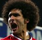 epa04455454 Manchester United's Marouane Fellaini (L) celebrates his goal with team mates during the English Premier League football match between West Bromwich Albion FC and Manchester United FC at The Hawthorns Stadium in Birmingham, Britain, 20 October 2014.  EPA/KIERAN GALVIN DataCo terms and conditions apply https://www.epa.eu/downloads/DataCo-TCs.pdf